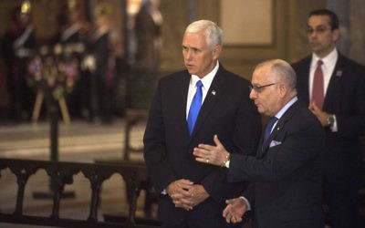 Vice President Mike Pence, left, with Argentine Foreign Minister Jorge Faurie during a wreath-laying ceremony at the Metropolitan cathedral in Buenos Aires, August 15, 2017. (Eitan Abramovich/AFP/Getty Images)