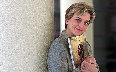 "Anita Diamant with a copy of ""The Red Tent"" in 2000. (David Bohrer/Los Angeles Times via Getty Images via JTA)"
