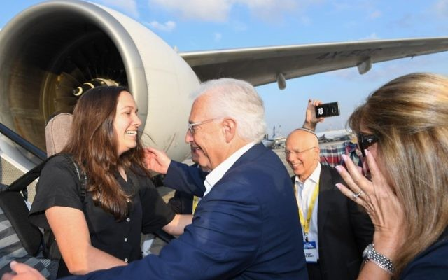 Talia Friedman, left, is greeted by her father, Ambassador David Friedman, as she arrives in Tel Aviv on an aliyah flight from New York, August 15, 2017 (Shahar Azran)