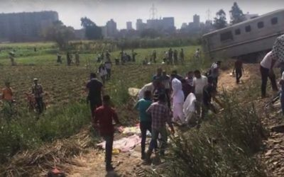 Survivors near the tracks after a train crash in Egypt, on Friday August 11, 2017. (Screen capture YouTube)