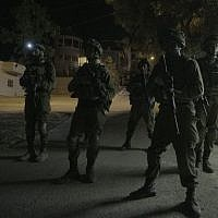 Illustrative: IDF soldiers conduct raids in the West Bank city of Yatta, near Hebron, on August 3, 2017. (IDF Spokesperson's Unit)