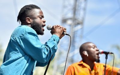 Musicians Kayus Bankole (L) and Alloysious Massaquoi of Young Fathers perform onstage during day 3 of the 2016 Coachella Valley Music & Arts Festival Weekend 2 at the Empire Polo Club on April 24, 2016 in Indio, California.  (Mike Windle/Getty Images for Coachella via JTA)