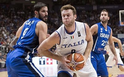 Illustrative: Italy's power forward Nicolo Melli (R) dribbles past Israel's small forward Omri Casspi (L) during the FIBA EuroBasket match between Italy and Israel at Menora Mivtachim Arena in Tel Aviv on August 31, 2017. (AFP Photo/Jack Guez)