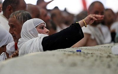 A female Muslim pilgrim partakes in the symbolic stoning of the devil at the Jamarat Bridge in Mina, near Mecca, which marks the final major rite of the hajj on September 1, 2017. (AFP / KARIM SAHIB)