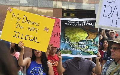 A map of Mexico as it was in 1794 is displayed as young immigrants and their supporters rally in support of Deferred Action for Childhood Arrivals (DACA) in Los Angeles, California on September 1, 2017. (AFP PHOTO / FREDERIC J. BROWN)