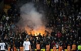 German supporters light flares during the FIFA World Cup 2018 qualification soccer match between Czech Republic and Germany in Prague, Czech Republic, on September 1, 2017. (AFP/Robert Michael)