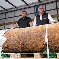 Illustrative: Dieter Schwetzler, right, and Rene Bennert of the Explosive Ordnance Disposal Division stand behind a World War II bomb they defused in Frankfurt, Germany, on September 3, 2017. (AFP PHOTO / Thomas Lohnes)