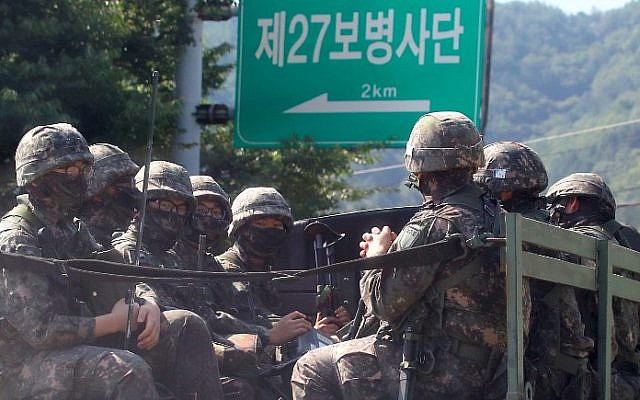 South Korean soldiers ride on a military truck in the border county of Hwacheon on September 4, 2017. (AFP Photo/Yonhap/STR)