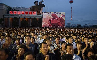 This photo taken on September 6, 2017 shows participants of a mass celebration in Pyongyang for scientists involved in carrying out North Korea's largest nuclear blast to date. (AFP/Kim Won-Jin)