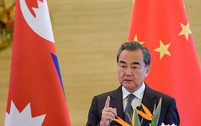 China's Foreign Minister Wang Yi speaks during a press conference in Beijing September 7, 2017. (AFP/POOL/Etienne Oliveau)