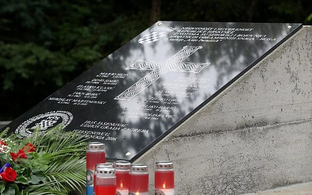 A memorial plaque with an Ustasha pro-Nazi slogan is pictured after it was moved from the vicinity of the WWII extermination camp of Janesovac, to a Croatian memorial site near Novska on September 7, 2017. (AFP PHOTO / STRINGER)
