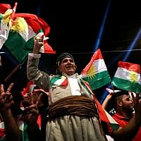 Iraqi Kurds celebrate while urging people to vote in the upcoming independence referendum in Arbil, the capital of the autonomous Kurdish region of northern Iraq, on September 8, 2017. (AFP Photo/Safin Hamed)