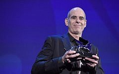 "Director Samuel Maoz receives the Silver Lion - Grand Jury Prize for his movie ""Foxtrot"" during the award ceremony of the 74th Venice Film Festival on September 9, 2017 at Venice Lido.  (AFP PHOTO / Tiziana FABI)"