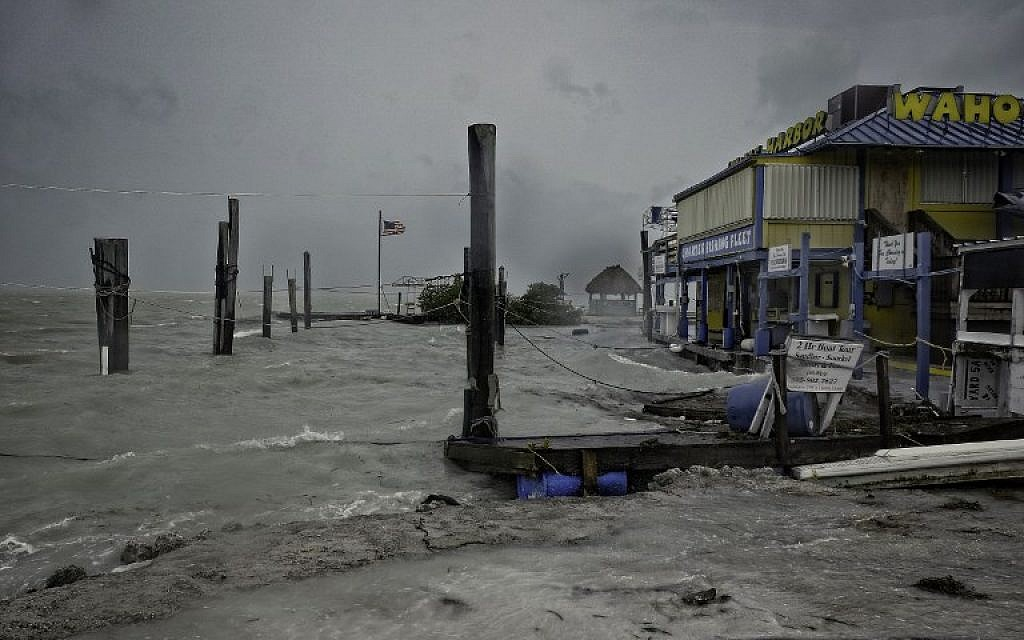 Rough surf churned up by the approaching hurricane damages the docks at Whale Harbor in the Florida Keys as winds and rain from the outer bands of Hurricane Irma arrive in Islamorada, Florida on September 9, 2017. (AFP/Gaston De Cardenas)