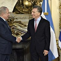 Prime Minister Benjamin Netanyahu, left, shakes hands with Argentina's President Mauricio Macri before a working meeting at the Casa Rosada presidential house in Buenos Aires on September 12, 2017.  (AFP / JUAN MABROMATA)