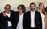 "Lebanese-French director Ziad Douieri (2nd L) poses with actors Adel Karam (2nd R), Diamand Bou Abboud (R) and award-winning Palestinian actor Kamal el-Basha (L) at the pre-screening of ""The Insult"" in Beirut on September 12, 2017. (AFP PHOTO / ANWAR AMRO)"