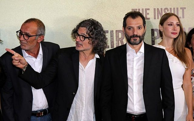 """Lebanese-French director Ziad Douieri (2nd L) poses with actors Adel Karam (2nd R), Diamand Bou Abboud (R) and award-winning Palestinian actor Kamal el-Basha (L) at the pre-screening of """"The Insult"""" in Beirut on September 12, 2017. (AFP PHOTO / ANWAR AMRO)"""