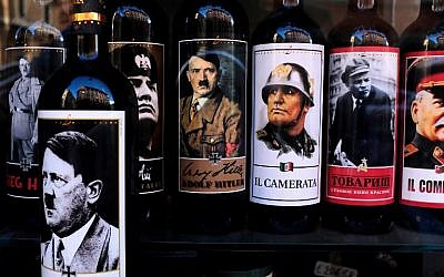 A picture taken on September 14, 2017 shows bottles of wine with pictures of Mussolini, Hitler, Lenin and Stalin at a shop in the center of Rome. (AFP PHOTO / Alberto PIZZOLI)