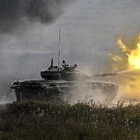"A Russian T-90 tank fired in Kubinka Patriot Park outside Moscow during the first day of the ""Army 2017"" International Military-Technical Forum on August 22, 2017. (Alexander Nemenov/AFP)"