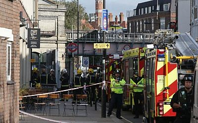 Members of the emergency services work near Parsons Green underground tube station in west London on September 15, 2017, following an incident on an underground tube carriage at the station. (AFP/Daniel Leal-Olivas)