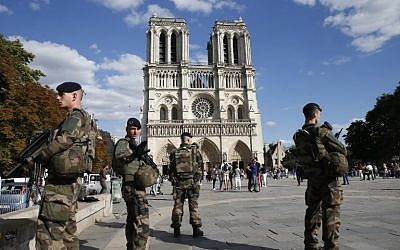 This file photograph taken on August 20, 2017, shows French soldiers as they stand alert outside the NotreDame de Paris Cathedral in Paris. (AFP/GEOFFROY VAN DER HASSELT)