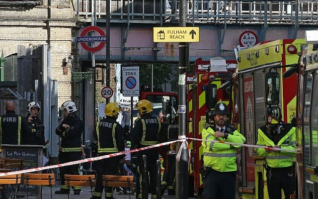 Members of the emergency services are seen outside Parsons Green Underground station in London on September 15, 2017, following a bombing attack on a subway train at the station. (AFP Photo/Daniel Leal-Olivas)