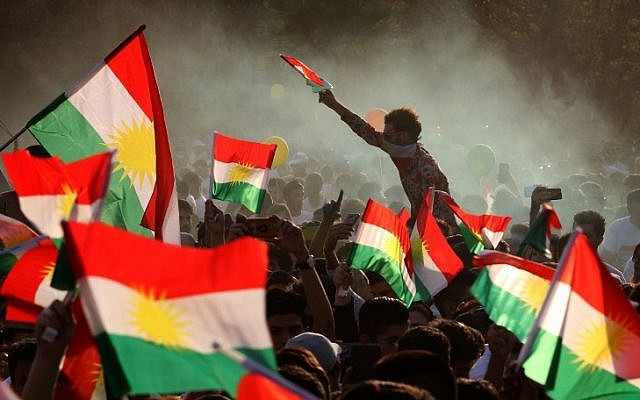Iraqi Kurds fly Kurdish flags during an event to urge people to vote in the upcoming independence referendum in Arbil, the capital of the autonomous Kurdish region of northern Iraq, on September 15, 2017. (AFP/ SAFIN HAMED)