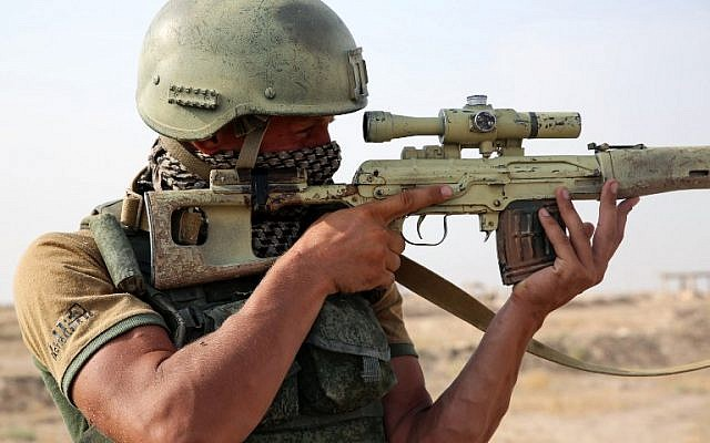 Illustrative: A picture taken during a press tour hosted by the Russian Armed Forces shows a Russian soldier looking through the scope of a sniper rifle on the outskirts of Syria's eastern city of Deir Ezzor on September 15, 2017. (AFP Photo/France2/Dominique Derda)