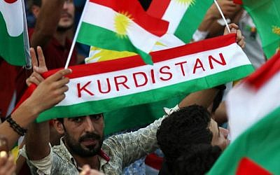 Iraqi Kurds fly Kurdish flags during an event to urge people to vote in the upcoming independence referendum in Irbil, the capital of the autonomous Kurdish region of northern Iraq, on September 16, 2017. (AFP/Safin Hamed)