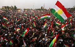 Iraqi Kurds fly Kurdish flags during an event to urge people to vote in the upcoming independence referendum in Arbil, the capital of the autonomous Kurdish region of northern Iraq, on September 16, 2017. (AFP/Safin Hamed)