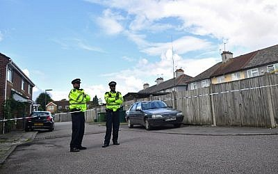 Police stand guard near a house in Sunbury, west of London, on September 18, 2017, as investigations into the September 15 attack on a London Underground tube train at Parsons Green station continued. (AFP Photo/Ben Stansall)