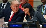 US President Donald Trump and US ambassador to the United Nations Nikki Haley speak during a meeting on United Nations Reform at the United Nations headquarters on September 18, 2017, in New York. (AFP PHOTO / TIMOTHY A. CLARY)