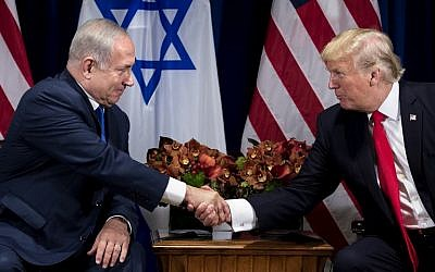 Prime Minister Benjamin Netanyahu (L) and US President Donald Trump shake hands prior to their meeting at the Palace Hotel in New York City ahead of the United Nations General Assembly on September 18, 2017. (AFP Photo/Brendan Smialowski)