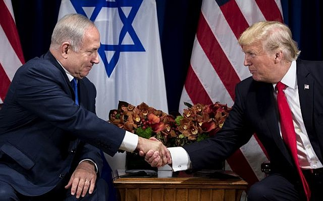 Prime Minister Benjamin Netanyahu (L) and US President Donald Trump shake hands prior to their meeting at the Palace Hotel in New York City ahead of the United Nations General Assembly on September 18, 2017.(AFP Photo/Brendan Smialowski)