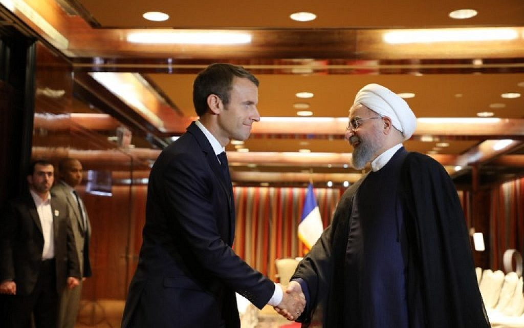 France's President Emmanuel Macron (L) greets Iranian President Hassan Rouhani at the Millennium Hotel in New York on September 18, 2017, in New York. (AFP Photo/Ludovic Marin)
