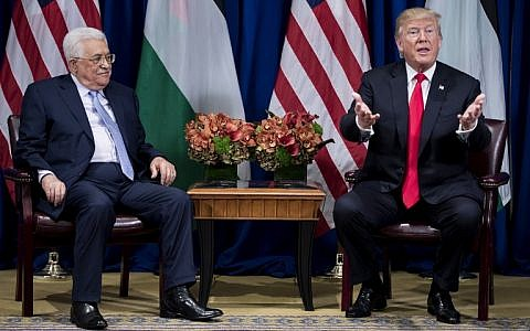 Palestinian Authority President Mahmoud Abbas (L) listens as US President Donald Trump speaks to the press before a meeting at New York's Palace Hotel during the 72nd UN General Assembly on September 21, 2017. (AFP Photo/Brendan Smialowski)