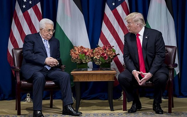 Palestinian Authority President Mahmoud Abbas listens while US President Donald Trump makes a statement for the press before a meeting at the Palace Hotel during the 72nd United Nations General Assembly on September 20, 2017, in New York. (AFP/Brendan Smialowski)