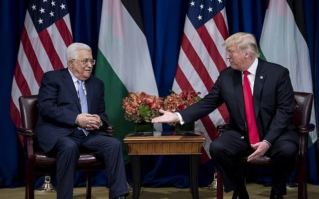US President Donald Trump reaches to shake Palestinian Authority President Mahmoud Abbas's hand before a meeting at the Palace Hotel during the 72nd United Nations General Assembly on September 20, 2017, in New York. (AFP Photo/Brendan Smialowski)