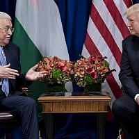 Palestinian Authority President Mahmoud Abbas speaks while US President Donald Trump listens before a  meeting at the Palace Hotel during the 72nd United Nations General Assembly on September 20, 2017, in New York. (AFP PHOTO / Brendan Smialowski)