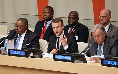 From left to right, front row: Malawi's President Arthur Peter Mutharika, French President Emmanuel Macron and UN Secretary General Antonio Guterres attend the 72nd Session of the United Nations General assembly at the UN headquarters in New York on September 20, 2017.  AFP/ ludovic MARIN)