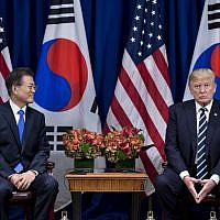 South Korea's President Moon Jae-in and US President Donald Trump wait for a meeting at the Palace Hotel during the 72nd United Nations General Assembly on September 21, 2017 in New York City.  (AFP PHOTO / Brendan Smialowski)
