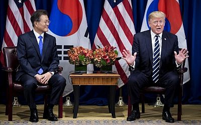 South Korea's President Moon Jae-in (L) listens as US President Donald Trump speaks to the press before a meeting at New York's Palace Hotel during the 72nd UN General Assembly on September 21, 2017. (AFP Photo/Brendan Smialowski)