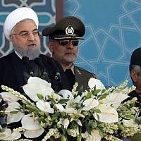 Iranian President Hassan Rouhani delivers a speech during the annual military parade marking the anniversary of the outbreak of its 1980-1988 war with Saddam Hussein's Iraq, on September 22, 2017, in Tehran. (AFP/stringer)
