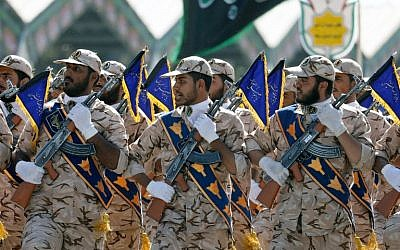 Illustrative: Iranian soldiers march during the annual military parade marking the anniversary of the outbreak of its devastating 1980-1988 war with Saddam Hussein's Iraq, on September 22, 2017 in Tehran. (AFP/ str)