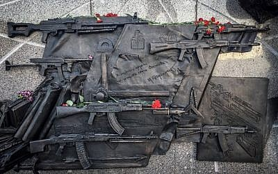 A view of a sketch allegedly featuring German StG44 rifle at a fragment of the newly unveiled monument to Mikhail Kalashnikov, the inventor of the AK-47 assault rifle, in downtown Moscow on September 22, 2017. (AFP PHOTO / Mladen ANTONOV)