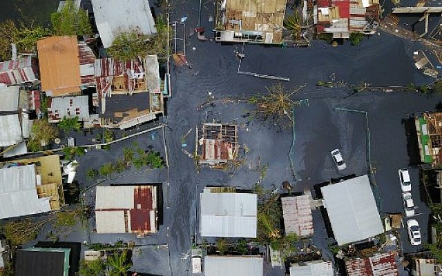 An aerial view shows the flooded neighborhood of Juana Matos in the aftermath of Hurricane Maria in Catano, Puerto Rico, on September 22, 2017. (AFP/Ricardo Arduengo)