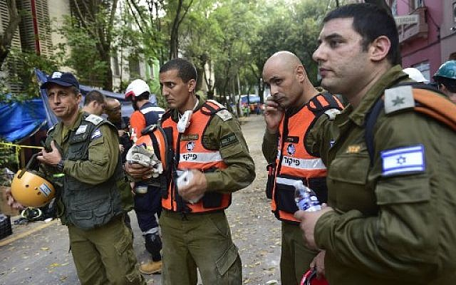 Israeli rescue workers are present as the body of Maria Ortiz, who survived the earthquake in Mexico City but died before the rescuers could get to her, is removed on September 22, 2017, three days after the powerful quake that hit central Mexico. (AFP PHOTO / Pedro Pardo)