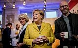 German Chancellor Angela Merkel (C) serves coffee to members of her Christian Democratic Union's election campaign team at a party event in Berlin on September 23, 2017, one day before general elections. (AFP Photo/dpa/Michael Kappeler)