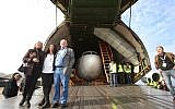 "Juergen Vietor (3rd L), former co-pilot of the old Boeing 737 plane seen next to him, former flight attendant Gabriele von Lutzau (L) and former flight passenger Diana Muell (2nd L) pose in front of the former ""Landshut"" aircraft of German airline Lufthansa, in the cargo space of an Antonov AN 124 cargo plane after landing at the airport in Friedrichshafen, southern Germany, on September 23, 2017. ( AFP PHOTO / dpa / Karl-Josef Hildenbrand )"