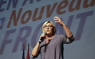 National Front party leader Marine Le Pen delivers a speech in Bruguieres,  France on September 23, 2017. (AFP Photo/Pool/Eric Cabanis)
